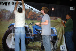 Local FFA members help Michael Peterson set up his exhibit in the Nashville Convention Center.