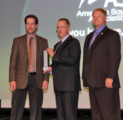 Bryan Perry, of BASF, (left) and ASA President Wade Cowan (right) present Steve Berger (center) with the National Conservation Legacy Award