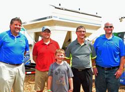 GROWMARK seed division mgr Mark Thornsbrough, winner Matt Davis and son Adam; John Walsh and Mike Fredrichson of Grainco FS