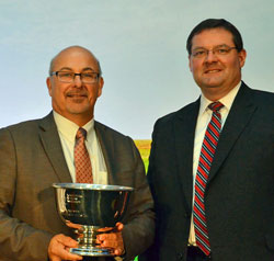 Joe Hodges of The Andersons; accepts awards from ARA CEO Daren Coppock, for Retailer of the Year