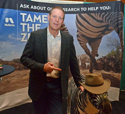 Comedian Damian Mason visits with Nufarm's Chip the Zebra