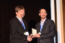 PrecisionAg Executive Editor Paul Schrimpf presents award to Dr. Brian Arnell, OSU