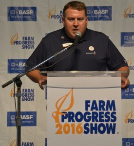 """Dion McBay, Monsanto, unveils the results of the new report, """"""""Charting a Path to Carbon Neutral Agriculture: Mitigation Potential for Crop Based Strategies,"""" during the 2016 Farm Progress Show."""