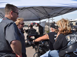 RFA board members Chuck Woodside and Dana Lewis chat with bikers getting free 10% ethanol fuel